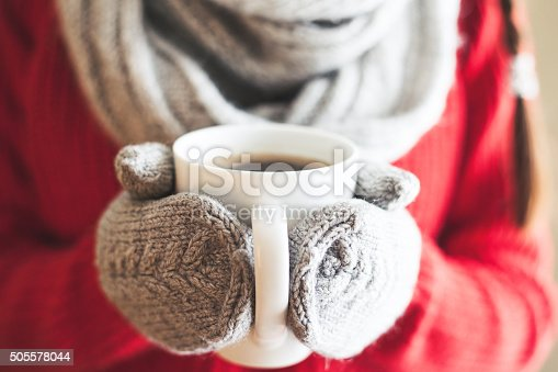 Woman Hands In Gloves Holding A Mug Stock Photo & More Pictures of Adult