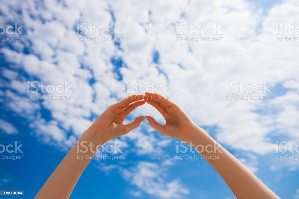 Woman hands in heart figure outdoors royalty-free stock photo