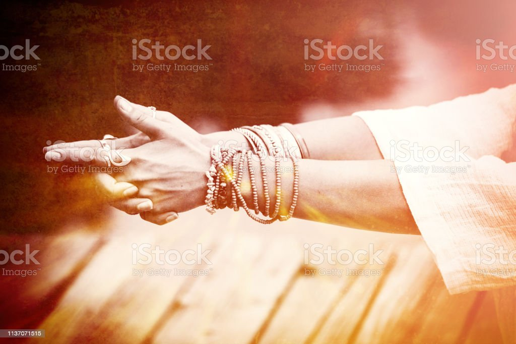 woman hands in yoga symbolic gesture stock photo