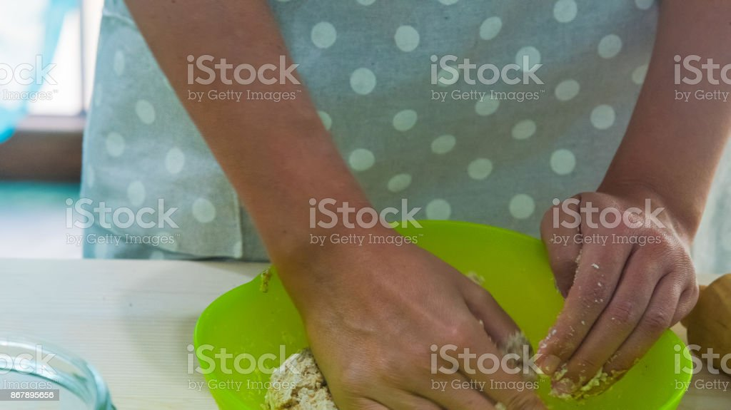 Woman hands kneading bread stock photo