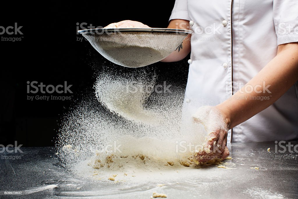 Woman hands kneading dough. stock photo