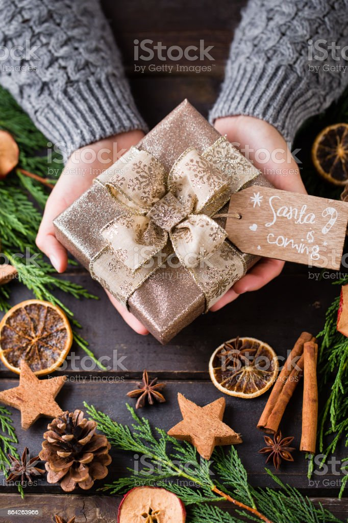 Woman hands making Christmas day gifts. royalty-free stock photo