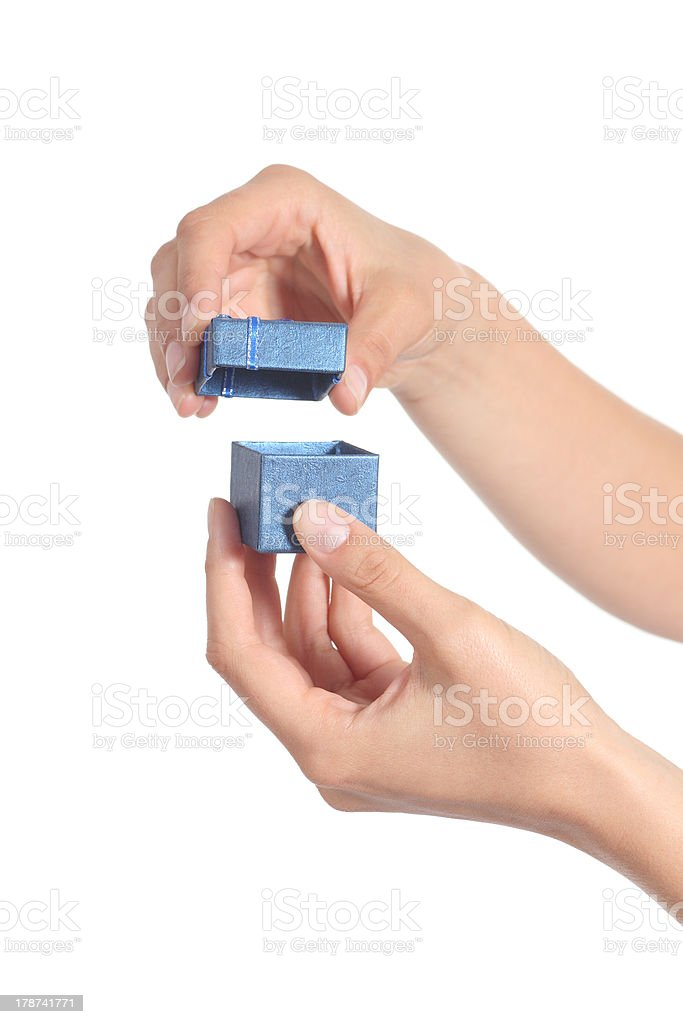 Woman hands opening a little gift box stock photo