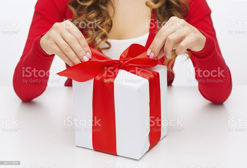 woman hands opening gift boxes stock photo