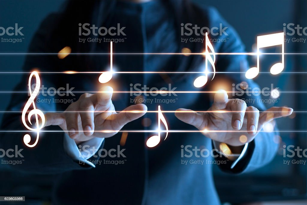 Woman hands playing music notes on dark background, music concept stock photo