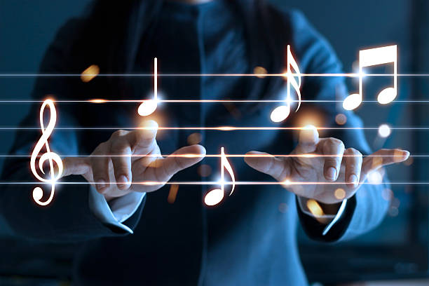 Woman hands playing music notes on dark background, music concept - foto de acervo