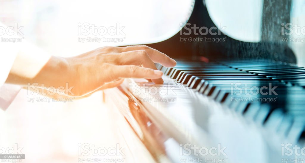 Woman hands playing piano stock photo