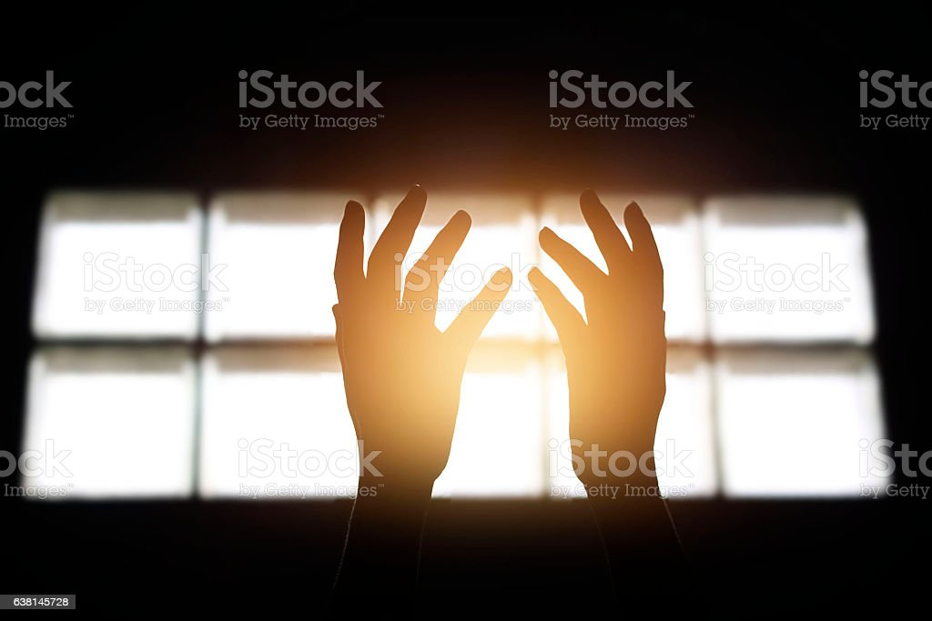 Woman hands praying for blessing from god in building stock photo