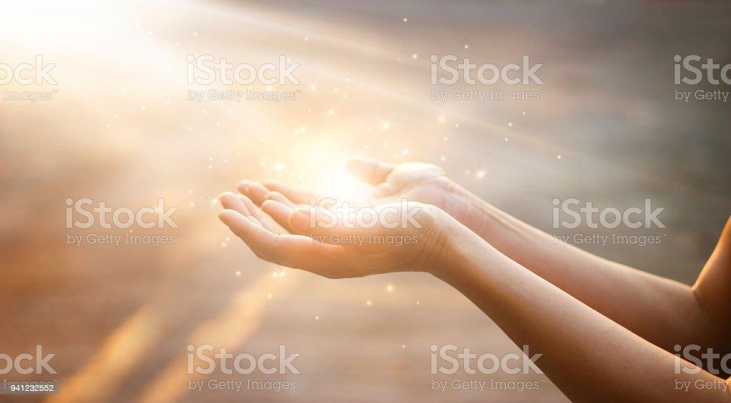 Woman hands praying for blessing from god on sunset background - Zbiór zdjęć royalty-free (Aspiracje)