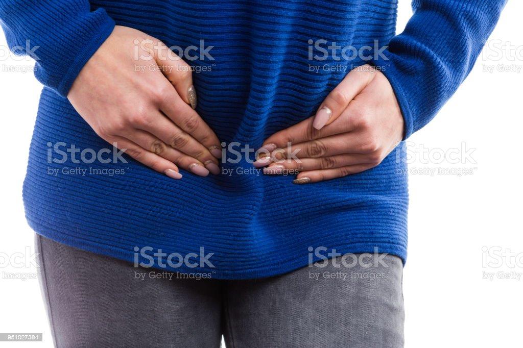 Woman hands pressing lower abdomen stock photo