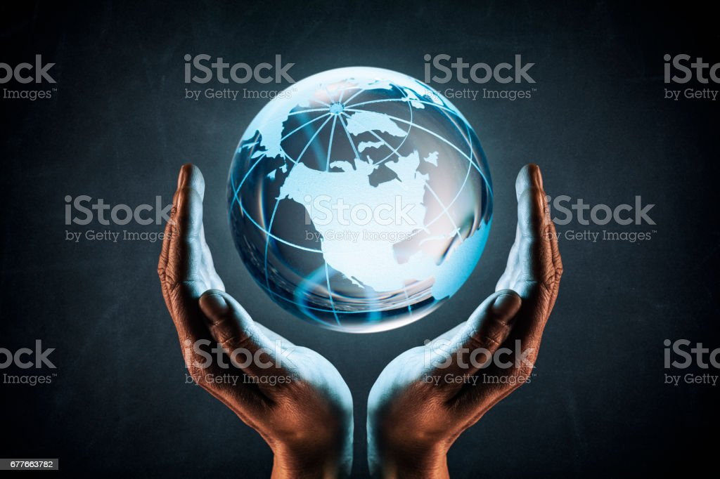 Woman hands protecting the earth concept - World Environment Blackboard stock photo