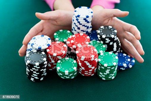 Woman hands pushing gambling chips