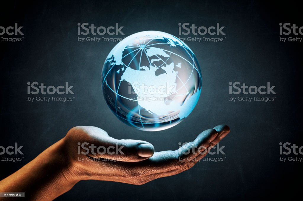 Woman hands supporting the earth concept - World Environment Blackboard stock photo