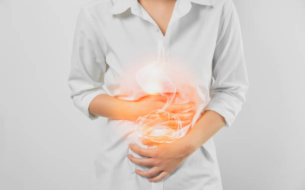 woman hands touching belly and stomach painful suffering from chronic gastritis on white background. healthcare concept. - acid stock pictures, royalty-free photos & images
