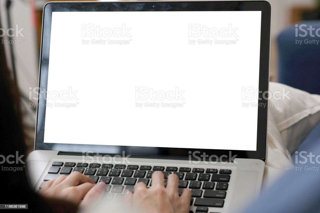 Woman hands typing laptop computer with blank screen for mock up...