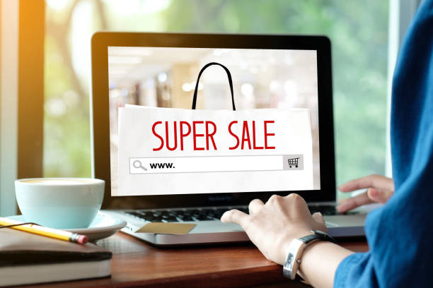 Woman hands typing laptop computer with www. on search bar over online super sale banner background, Holiday shopping online, business and technology stock photo
