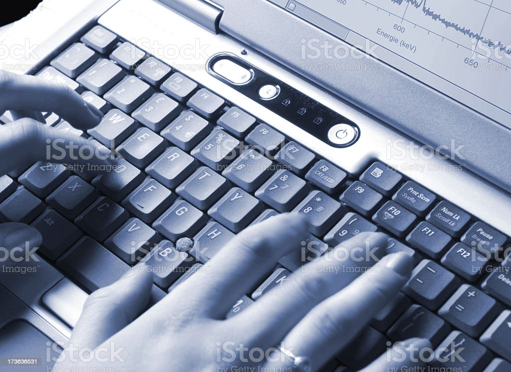 Woman hands typinh on Measuring notebook keyboard royalty-free stock photo