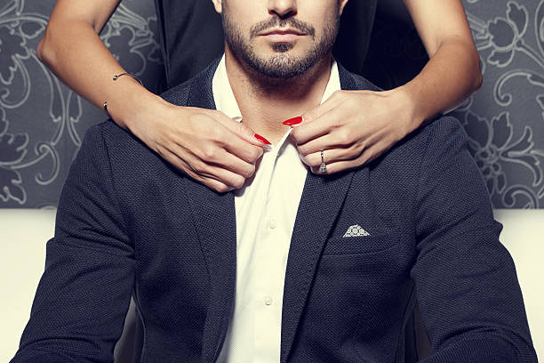Woman hands undress rich man Woman hands undress rich man, concept undressing stock pictures, royalty-free photos & images