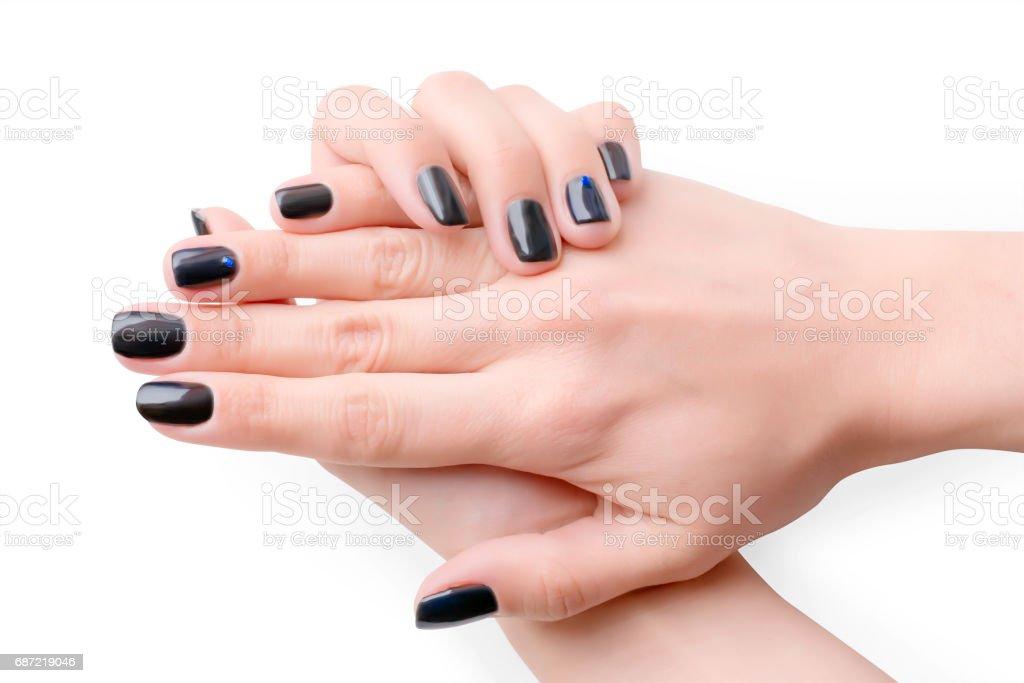 Woman hands with black manicure stock photo