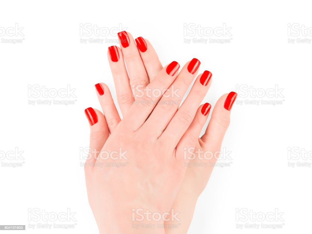 Woman hands with bright red nail polish stock photo
