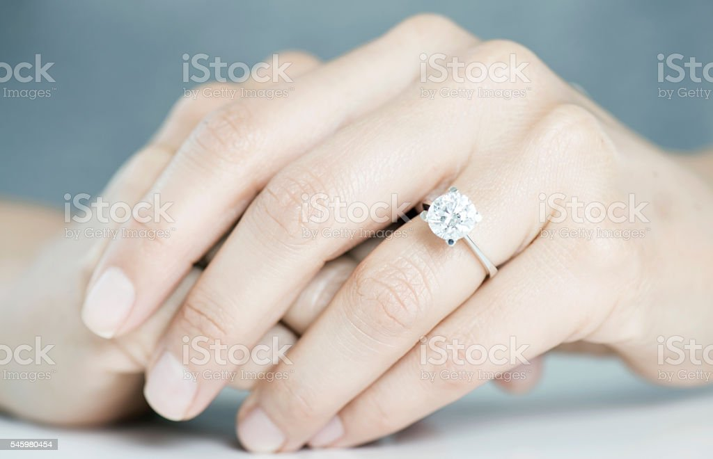 Woman Hands With Engagement Ring Stock Photo