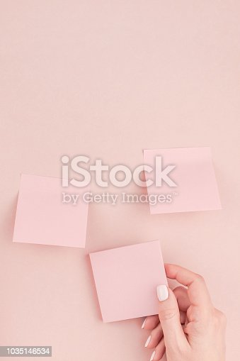831932306 istock photo Woman hands with paper stickers 1035146534