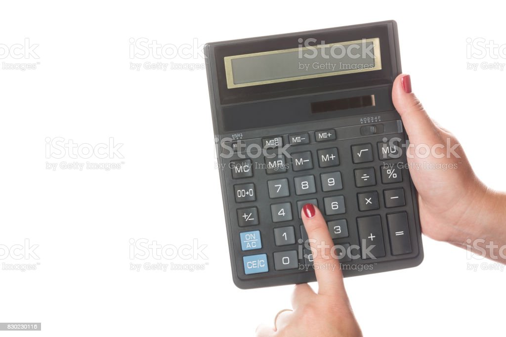 Woman hands with red nails holding calculator isolated on white stock photo
