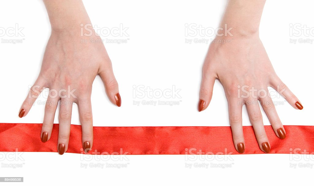Woman hands with red ribbon royalty free stockfoto