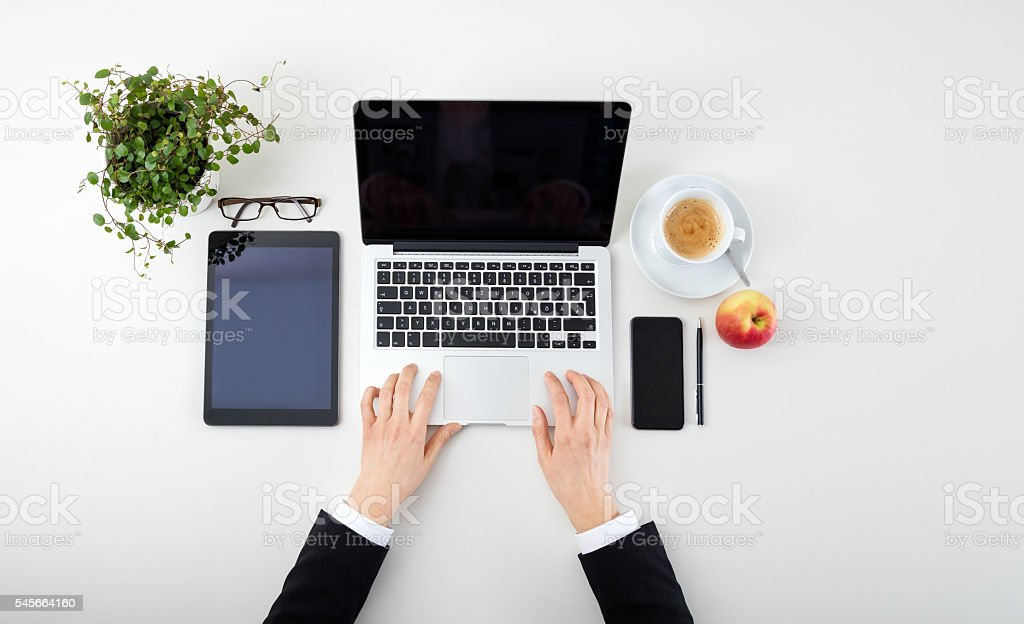 Woman Hands With Tablet, Laptop, Smartphone  and coffee stock photo