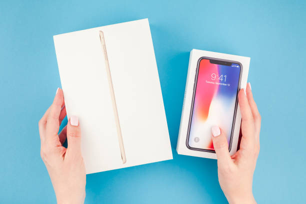 Woman hands with the box of Apple devices stock photo