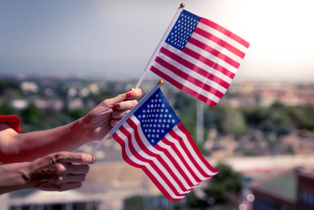 woman hands with usa national flag - family 4th of july zdjęcia i obrazy z banku zdjęć