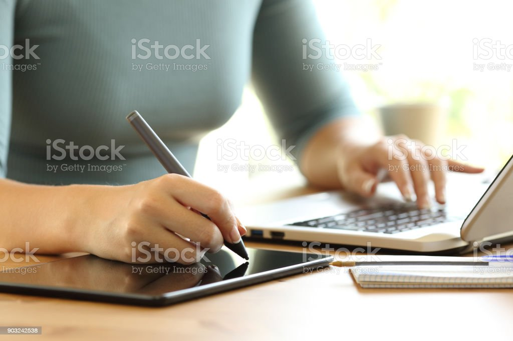 Woman hands working drawing in a digital tablet stock photo