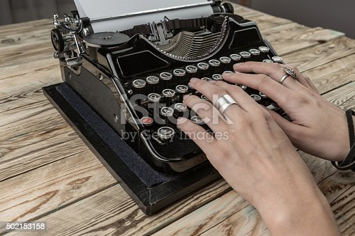 istock Woman Hands writing on old typewriter. 502153158
