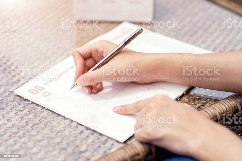 Woman hands writing plan on notebook, planning agenda and schedule...