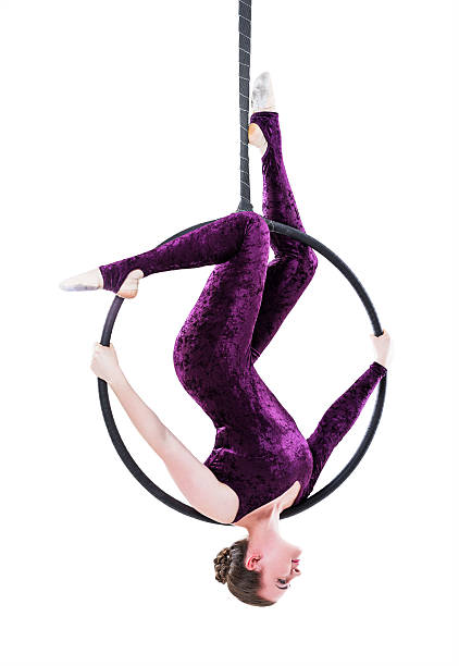 Woman hanging in aerial ring, isolated on white – Foto