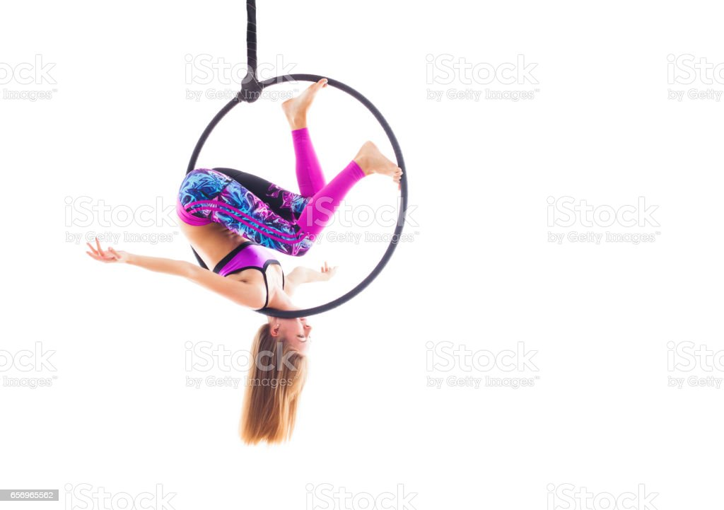 Woman hanging in aerial ring, isolated on white stock photo