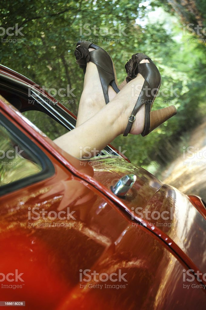 Woman hanging out legs. royalty-free stock photo