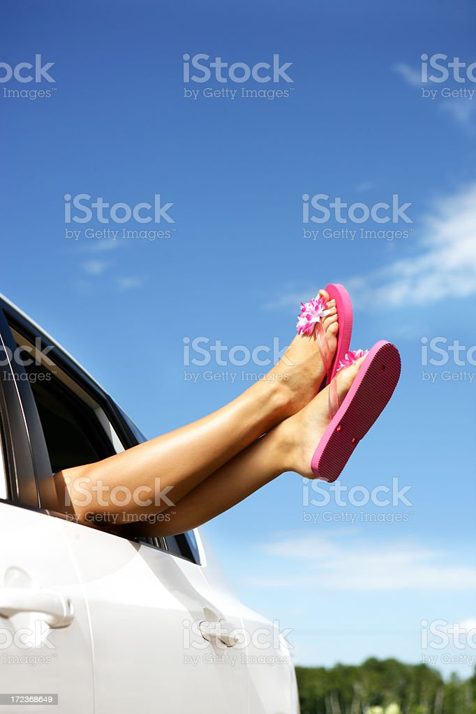 Woman hanging out legs royalty-free stock photo
