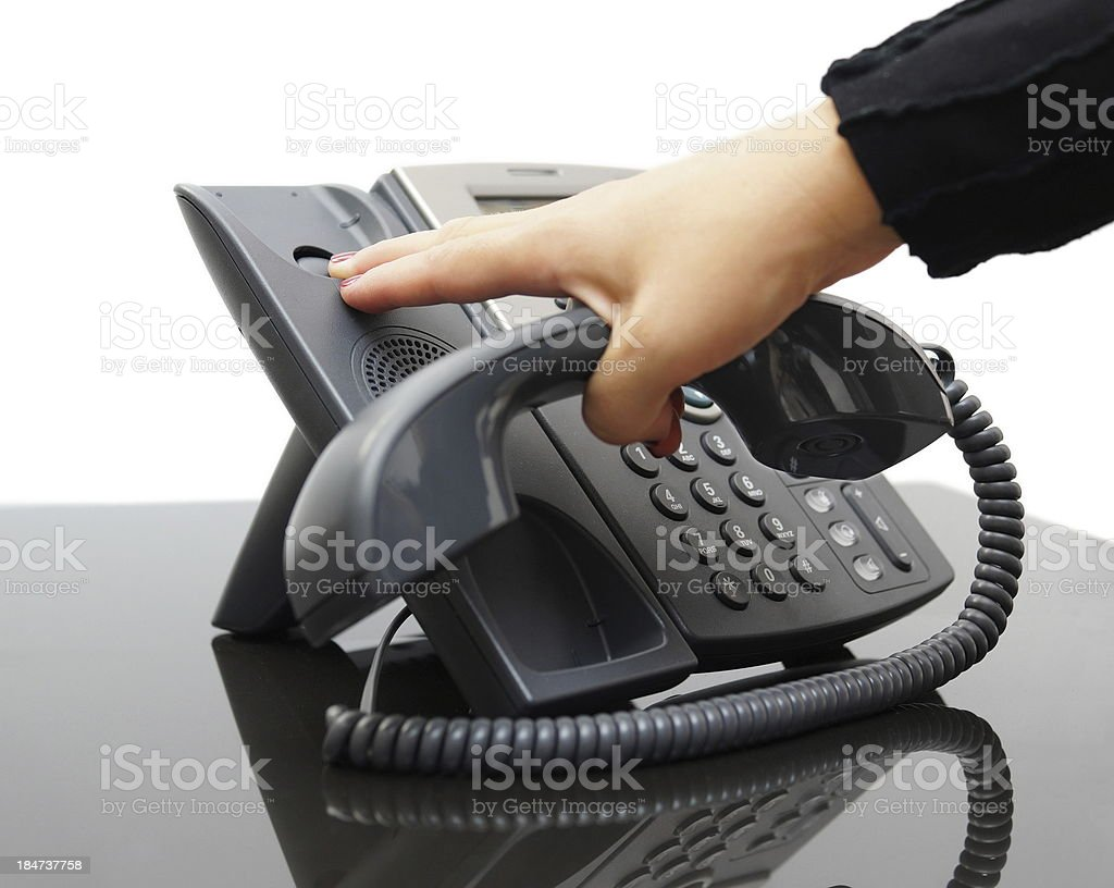 woman hanging up the phone stock photo