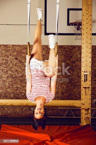 istock Woman hanging upside down in gymnastic rings 182238855