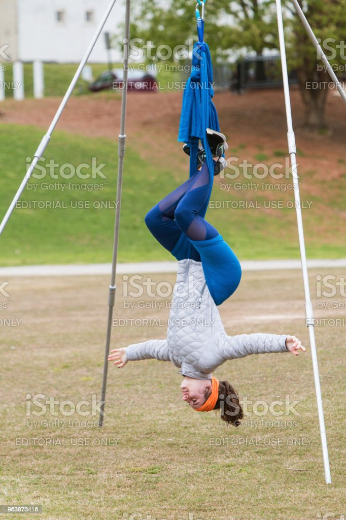 Woman Hangs Upside Down In Atlanta Aerial Yoga Class - Royalty-free Adult Stock Photo