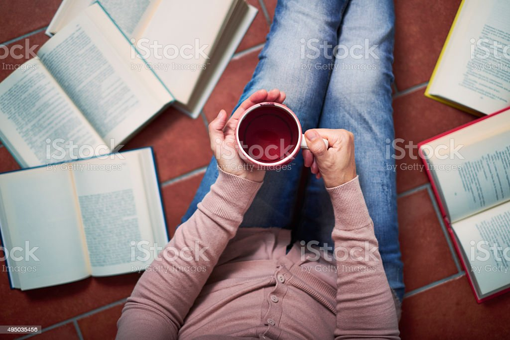 Woman has a break from reading royalty-free stock photo