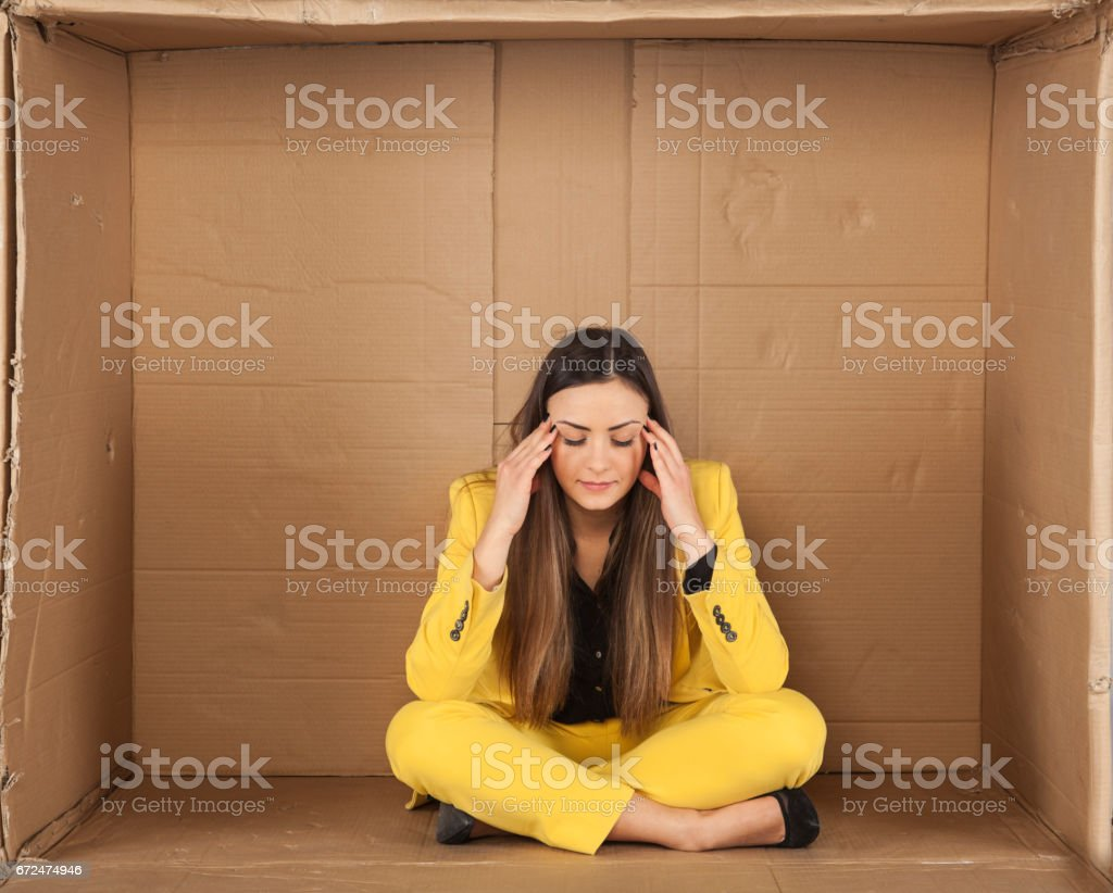 woman has a headache, a small room stock photo