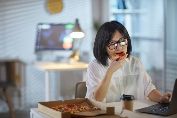 744 Asian Person Working While Eating In Office Stock Photos, Pictures &  Royalty-Free Images - iStock