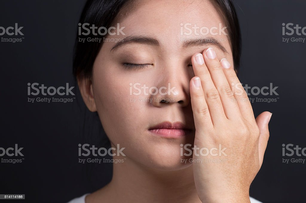 Woman has a pain in eye stock photo