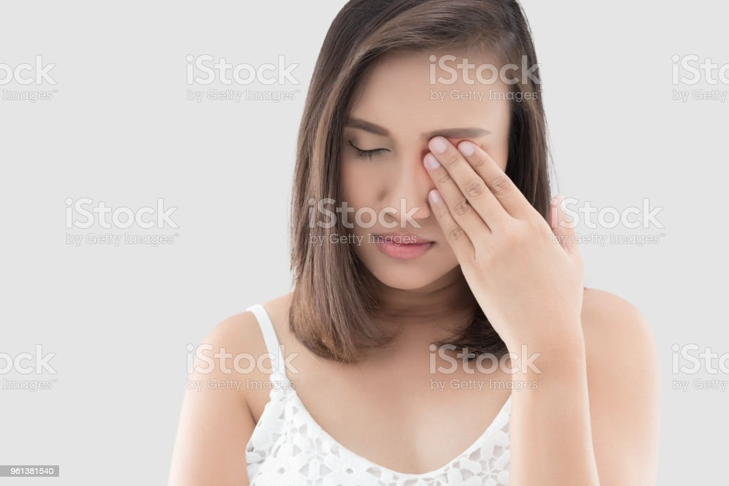 Woman has a pain in the eye stock photo