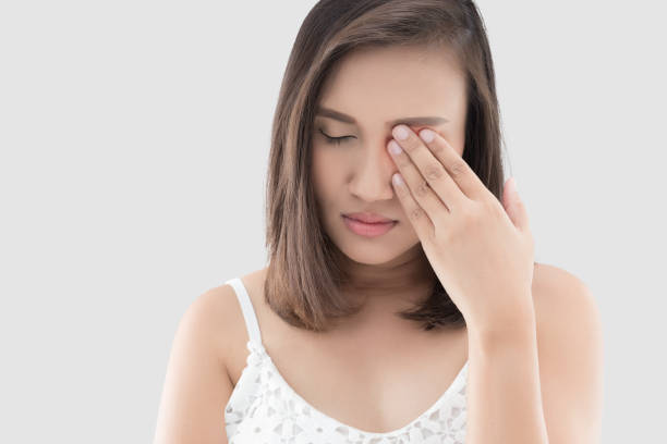 woman has a pain in the eye - eye stock pictures, royalty-free photos & images