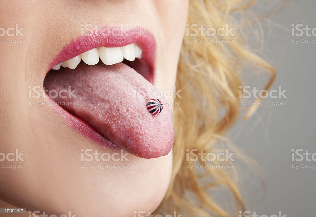 Woman has a piercing in the language stock photo