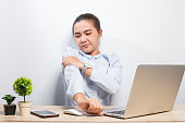 istock Woman has arm pain at office 960440514