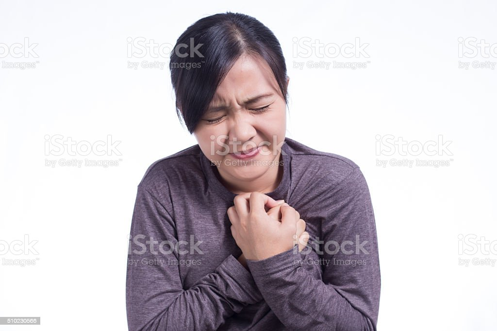 Woman Has Chest Pain on Isolated White Background stock photo